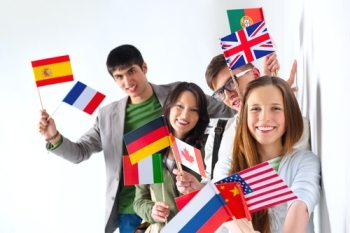 AuPairs_holding_international_flags.ss